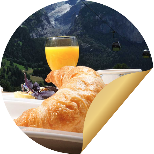 Tasty breakfast in front of an impressive mountain view, one of the many perks of a stay in the BODMI romantic hotel Grindelwald