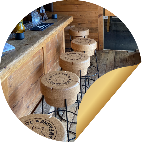 Rustic stools made from cork, located in the bar of the BODMI romantic hotel Grindelwald