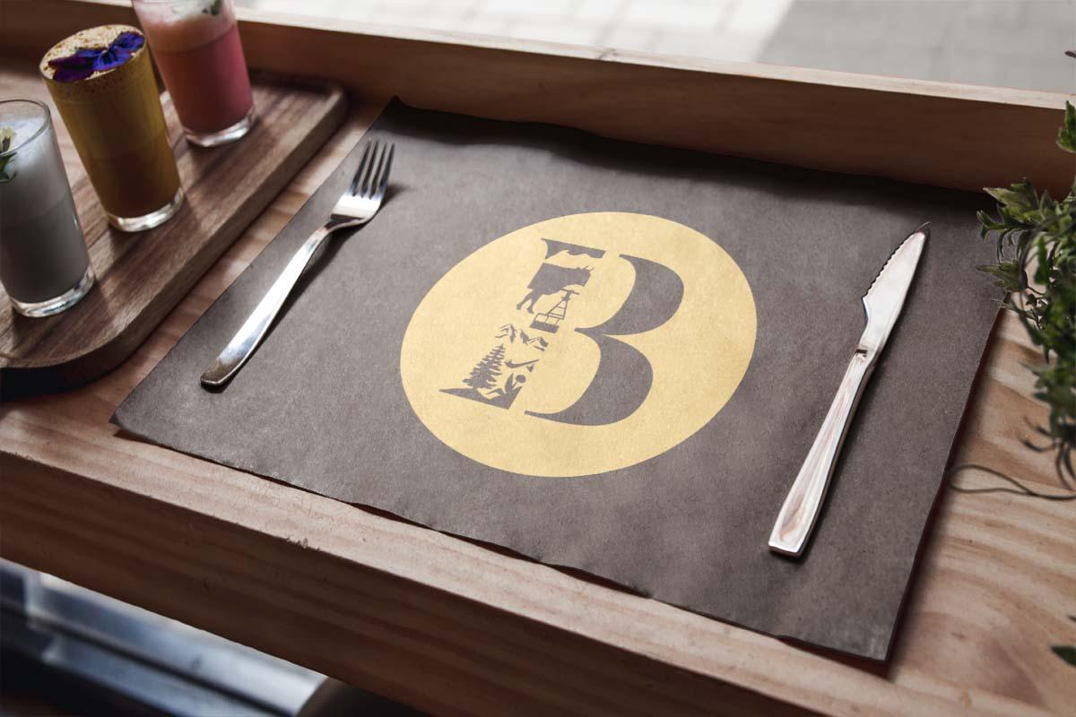 Eine Unterlage mit dem Logo des Bodmi Erholungshotel im Restaurant BellaVista